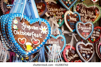 typical souvenir at the oktoberfest in munich - a gingerbread heart - lebkuchenherz - translation: greetings from oktoberfest