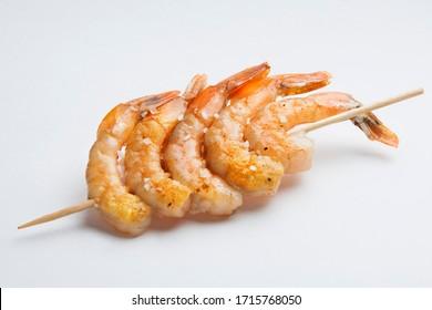 typical spanish food grilled prawn skewer