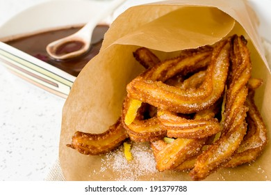 Typical Spanish fried pastry for dessert - churros