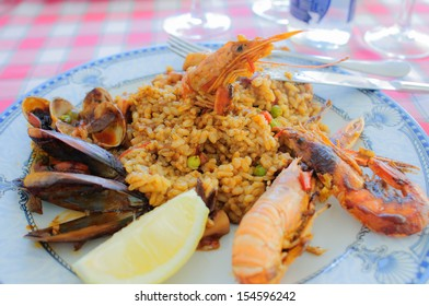 Typical spanish seafood paella, served in a restaurant in Costa Brava