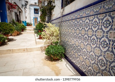 Typical Spanish tile on the house in a street of Santa cruz disctrict