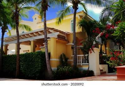 A typical spanish/mediterranean style house, common to all the Caribbean. Concrete construction to survive all weather conditions. Colorful and alive style.
