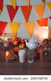 A typical spread of iftar or suhoor food . two glasses of milk and water. beautiful lights , lantern. a variety food is consumed  after sunset during holy month of Ramadan