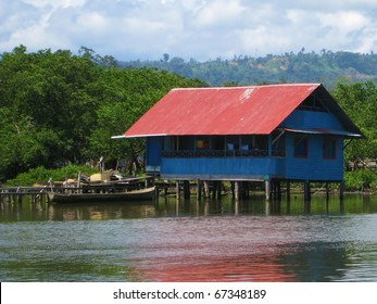 Typical Stilt House Over Water With Dugout Canoe, Almirante, Bocas Del  Toro, Central