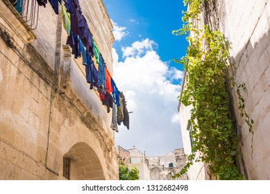Typical street in an italian town with hanging laundry