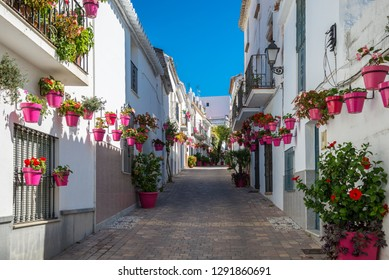 A typical street in old city Estepona with colorful flower pots. Estepona, Andalusia, Spain