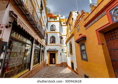 Typical street in Santa Cruz Quarter (famous historical part of Seville), Seville, Andalusia, Spain. June 7, 2013.