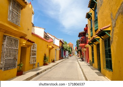 Typical street scene in Cartagena, Colombia of a street with old historic colonial houses on each side of it