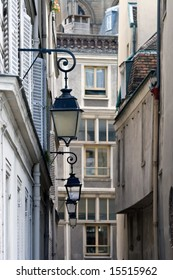 Typical Street scene on Saint Louis Island in Paris. Focused on front lamps.