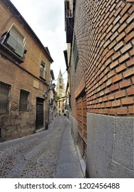 Typical street of Toledo, Spain, with de Cathedral background, famous for the narrowness, which allows that in summer there is much shade to be able to walk,