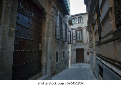 Typical street view with antique stone houses in old town in early morning. Toledo, Castilla La Mancha, Spain, Western Europe.