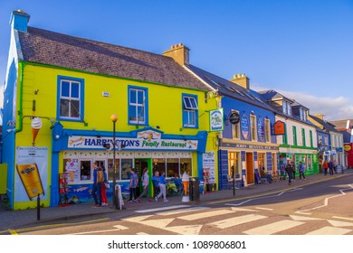 Typical street view in Dingle with its colorful houses - KERRY / IRELAND - MAY 6, 2018