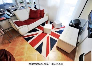 Typical student flat or single people with modern and clean decor. Carpet with British flag and furniture light and bright interior design for the house.