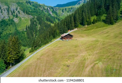 Typical Swiss chalets, Alpine forest trees and sloping meadows complete the picture