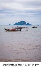 Typical thai boats on the beach in Krabi, Thailand