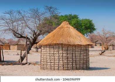Typical thatched-roof African round hut in Botswana.