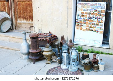 Typical tourist shop with souvenirs and antiques. Samovar, kerosene lamp,  vintage chest, vitage iron, primus, mortar pestle