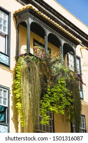 Typical traditional balconies with flowers on a house in Santa Cruz de La Palma, Spain.