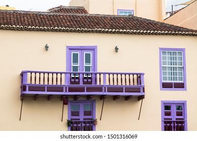Typical traditional balcony in purple color on a house in Santa Cruz de La Palma, Spain.