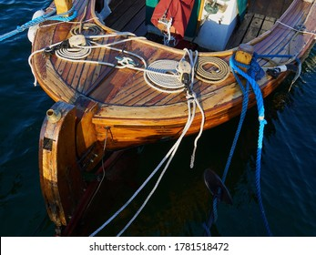 Typical traditional colorful small Danish fishing dingy boat in a harbour at Funen Denmark