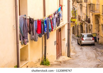 A typical and traditional view of someone's washing hung out to dry on a balcony, in Sicily, Italy.