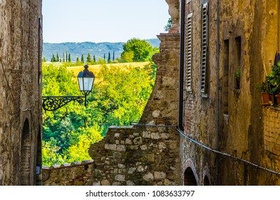 Typical Tuscany landscape framed by a medieval wall in Colle val d'Elsa, Italy