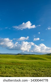 Typical Tuscany landscape with hills, green trees and houses, Italy.