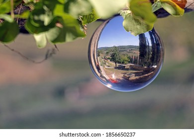 Typical Tuscany landscape reflected in a crystal ball.