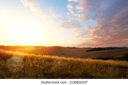 typical Tuscany landscape; sunset over rolling hills