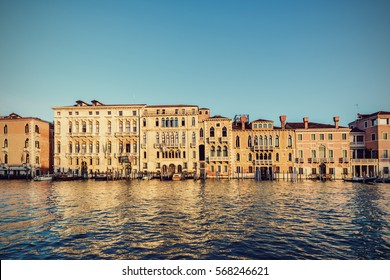 Typical venetian buildings from the waterside of Grand Canal int the golden hour, Venice (Venezia), Italy, Europe, Vintage filtered style