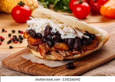 The typical Venezuelan Arepa called Pabellon, which has seasoned minced meat, fried plantain, black beans and white cheese
