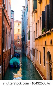 Typical Venice narrow water canal and old traditional colorful buildings. Italy, Europe.