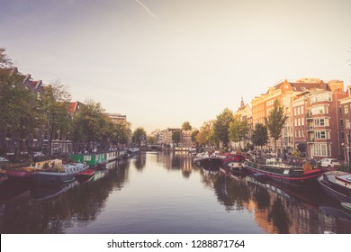 Typical view of canal embankment in historic center of city, Amsterdam, Netherlands
