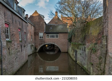 Typical view on old houses in the historic center of Den Bosch, capital of the Noord-Brabant province in the Netherlands, with the river Dieze streaming under the dwellings