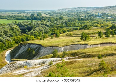Typical view of Oskol river valley surrounded by chalk hills with a deep canyon walls behind steppe patch in foreground, Belogorod region, southern Russia