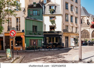 Typical view of the Parisian street with tables of cafe in Paris, France. Architecture and landmarks of Paris. Postcard of Paris