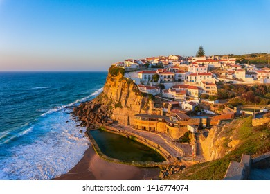 Typical village Azenhas do Mar on top of oceanic cliffs at sunset, Portugal