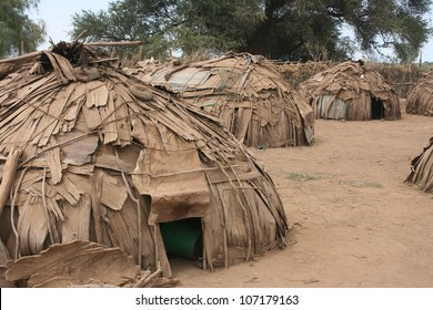 A typical village of the Dasanesh people of the Omo Valley in Ethiopia consists of huts constructed mostly of tree bark.