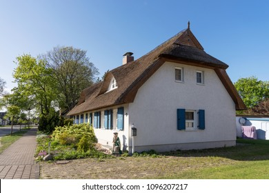 Typical village house with reed roof in Usedom, Germany