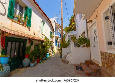 Typical village houses in Koroni fish village alley with flower and pots decoration.  Koroni, Peloponnese, Greece