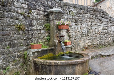 Typical village well in the Ardeche district, France