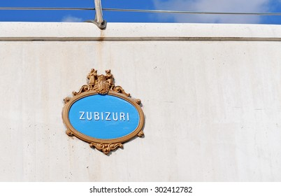 typical vintage street sign in bilbao, spain, basque country on the famous pedestrian zubizuri bridge