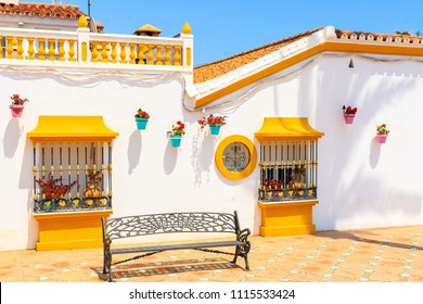 Typical white architecture with white houses and colorful decorations in Estepona town, Costa del Sol, Spain