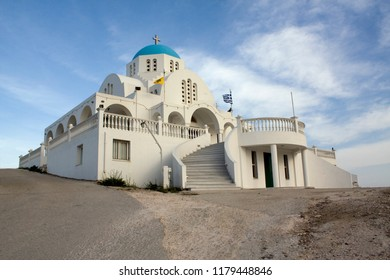 Typical white and blue Greek orthodox church in Keratea, near Athens, Greece, at sunset.