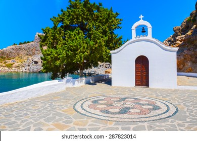 Typical white church in St. Paul's bay near Lindos town, Rhodes island, Greece