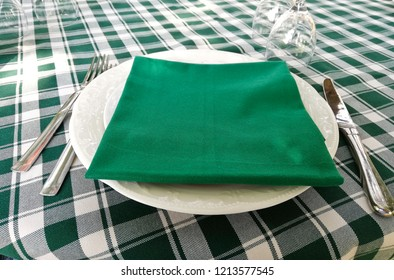 typical white and green tablecloth laid on a restaurant table