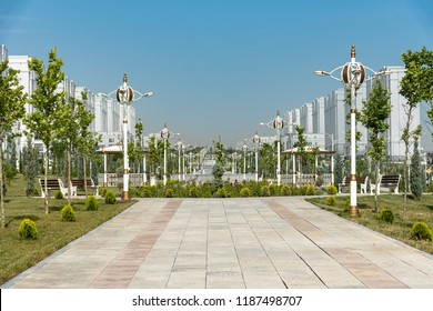 typical white marble-clad building surrounded by fountains in the Independance Park in Ashgabat, Turkmenistan