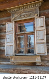 Typical window in wooden wall of house of nineteenth century in Russia