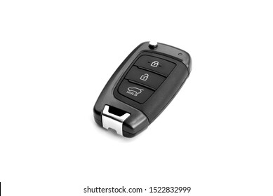 Typical wireless car key isolated on white background. Keyless entry remote key to modern vehicle. Device with buttons: lock, unlock doors and trunk opening. No metal shaft.