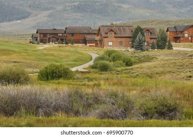 typical wood style homes in rural Colorado in the Rockie Mountains Preserve.  The homes are near a golf course.